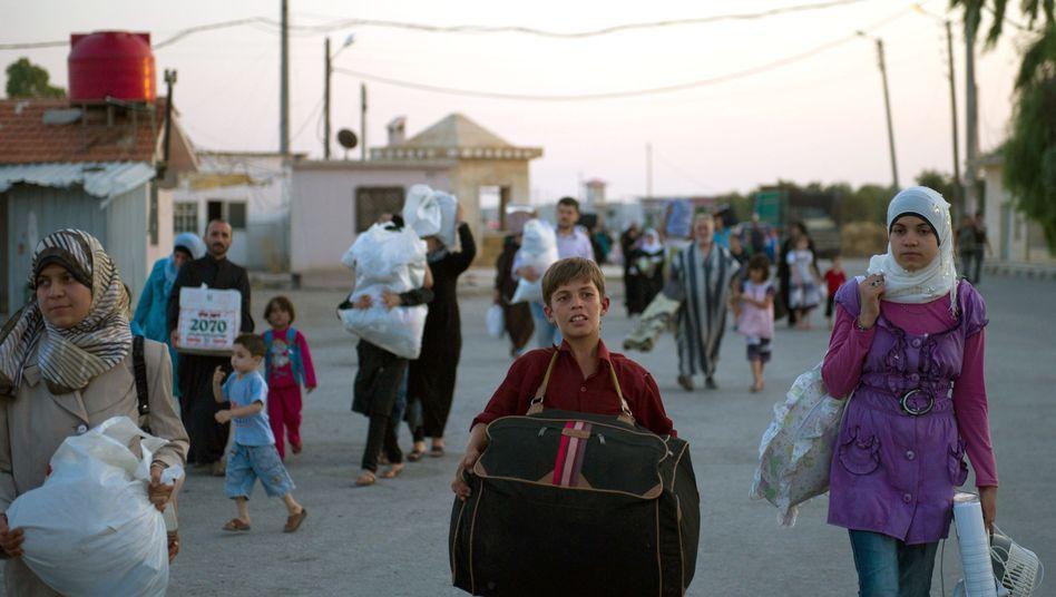 Syrer an türkischer Grenze: Warten auf den Grenzübertritt