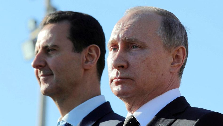 Wladimir Putin (r) und Baschar al-Assad (Archiv)