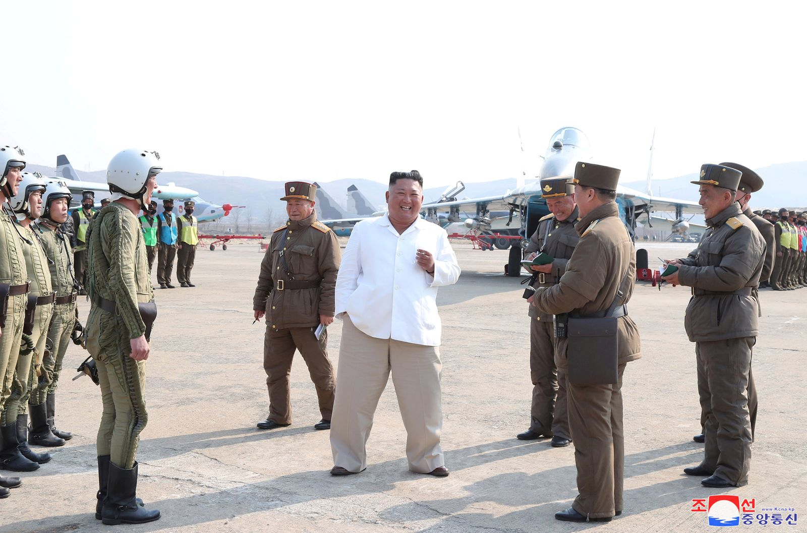 North Korean leader Kim Jong Un gives field guidance during his visit to a pursuit assault plane group under the Air and Anti-Aircraft Division in the western area