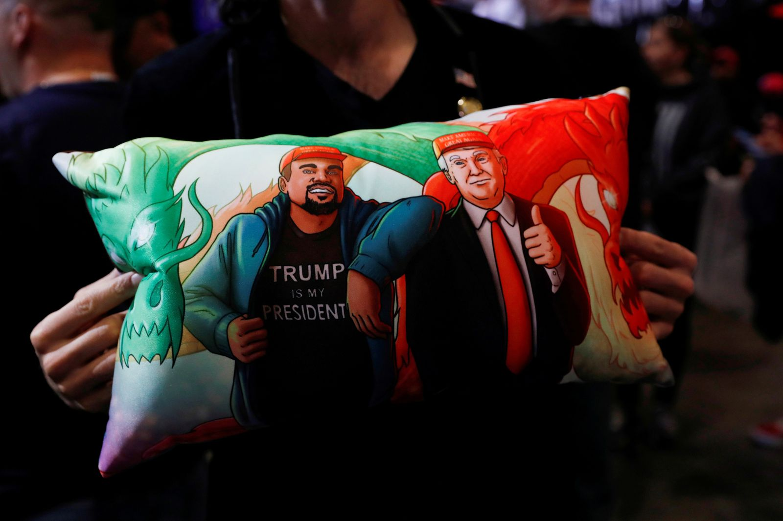 FILE PHOTO: A supporter of U.S. President Donald Trump holds a pillow of him and Kanye West at his campaign rally in Las Vegas, Nevada