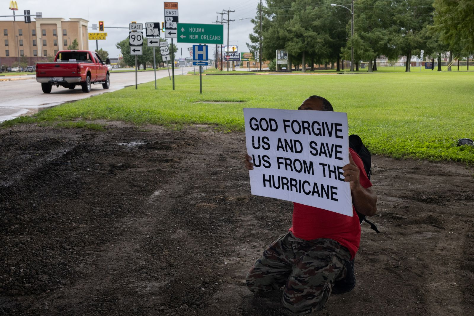Man holds placard ahead of Hurricane Ida in Louisiana