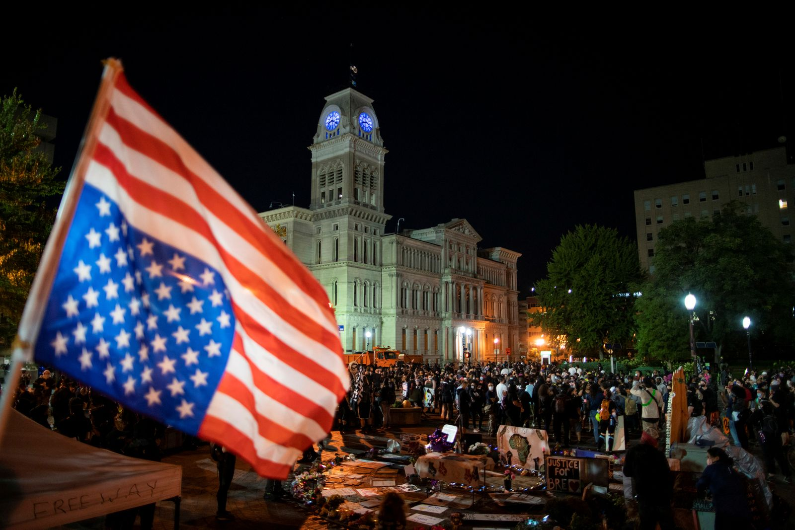 Demonstrators wait for the start of the curfew at Jefferson Square after a grand jury decided not to bring homicide charges against police officers involved in the fatal shooting of Breonna Taylor, in Louisville