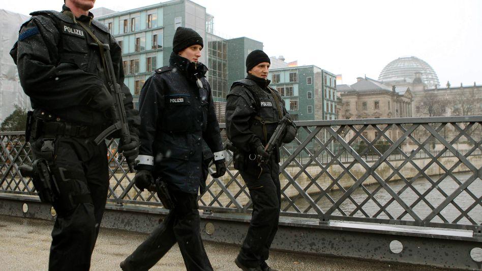 German police officers patrol near the German parliament.