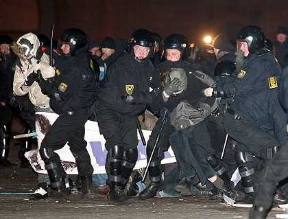 Police detain supporters of opposition presidential candidate Alexander Milinkevich at a makeshift camp in central Minsk March 24.