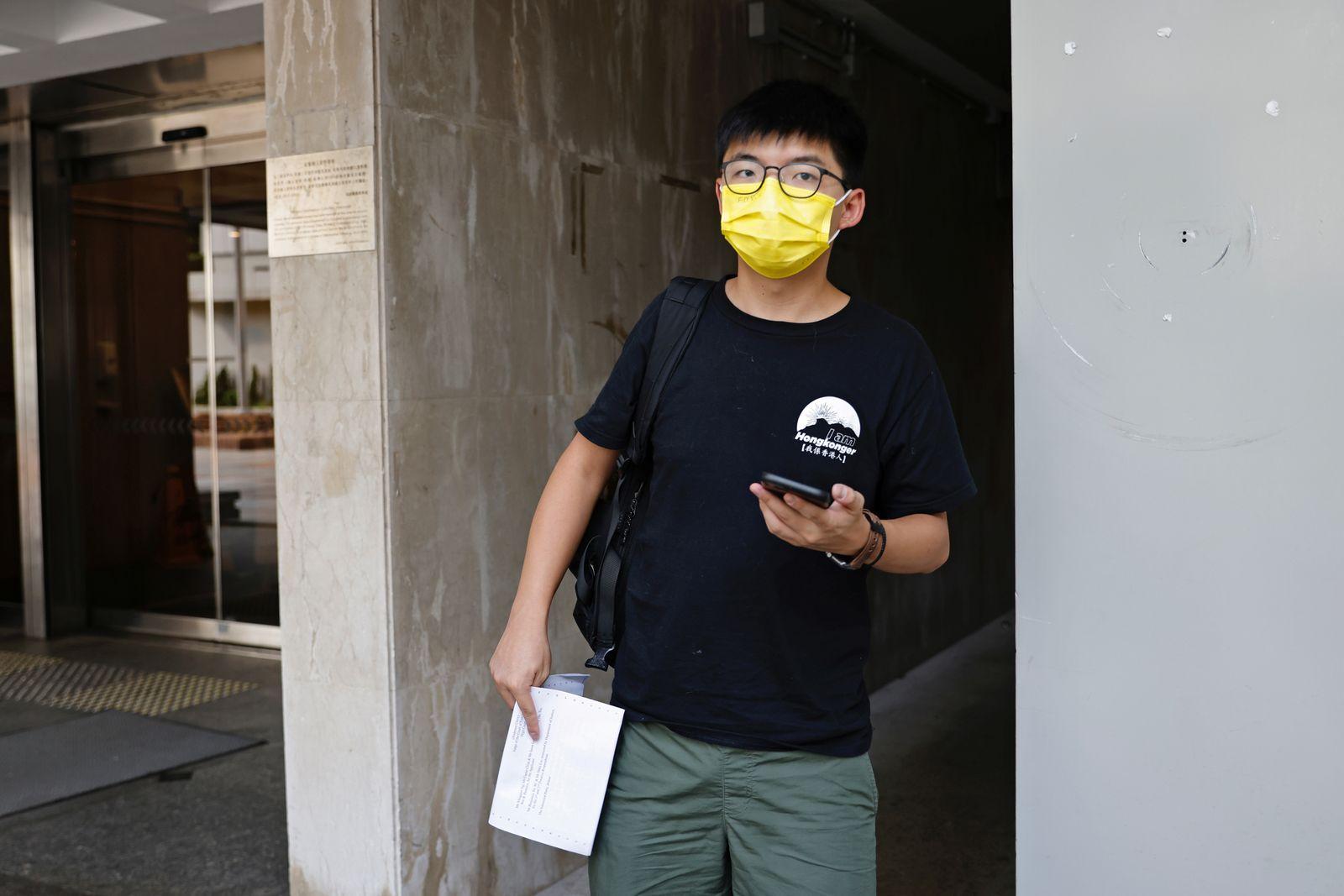 Joshua Wong leaves High Court in Hong Kong