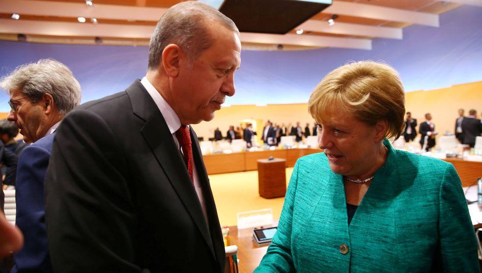 Recep Tayyip Erdogan, Angela Merkel am Ende des G20-Gipfels in Hamburg