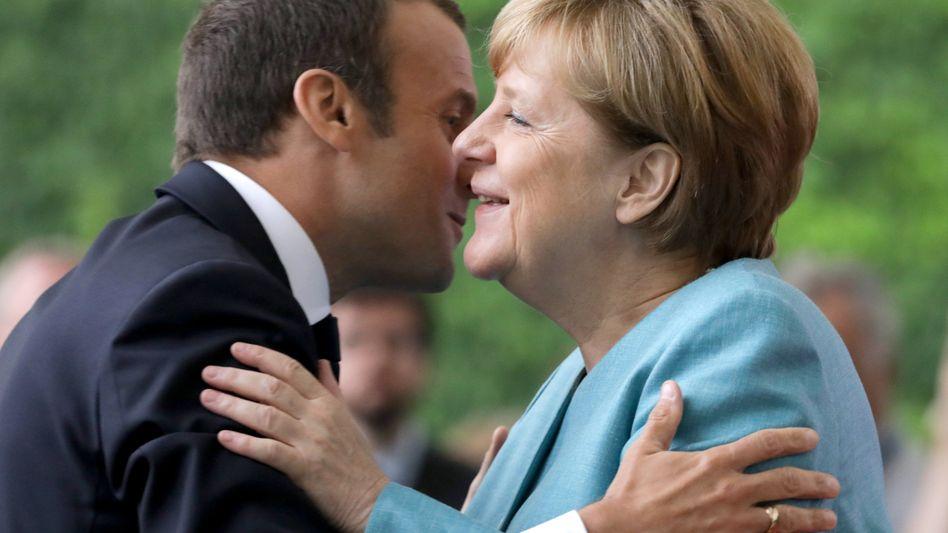 French President Emmanuel Macron and German Chancellor Angela Merkel.