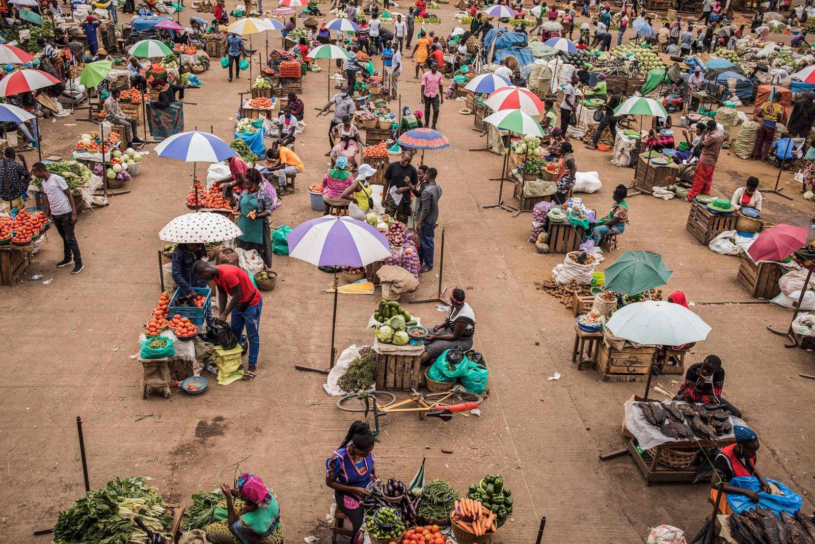 TOPSHOT-UGANDA-HEALTH-VIRUS-ECONOMY
