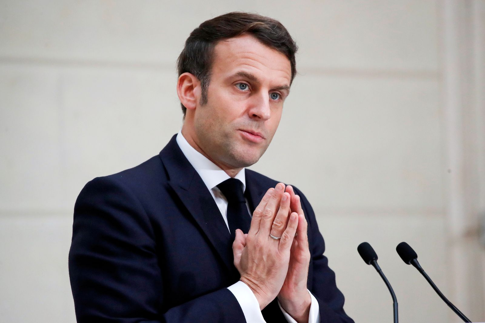 FILE PHOTO: French President Emmanuel Macron delivers a speech to the French Bakery and Pastry Federation members next to the traditional epiphany cake, in Paris
