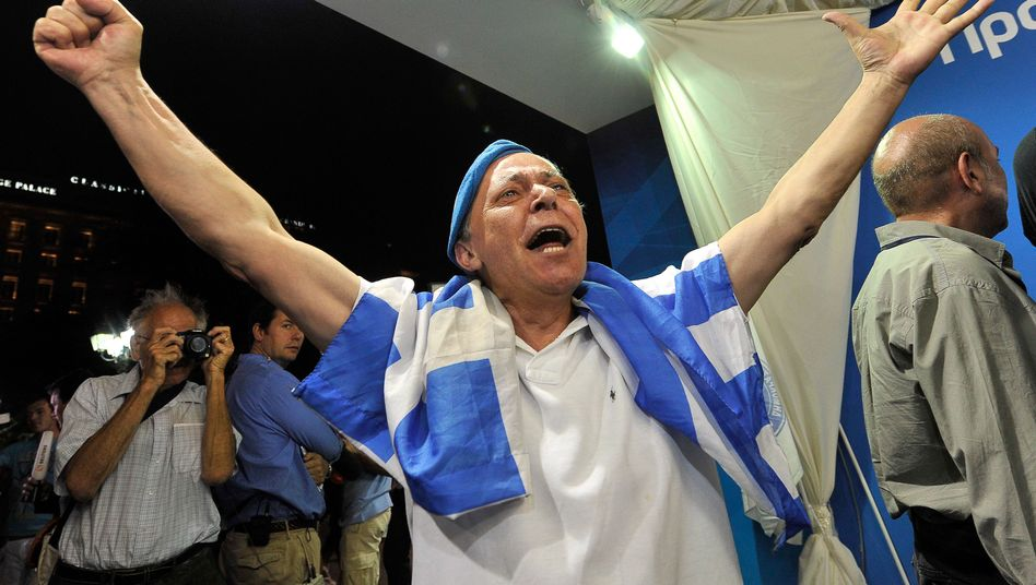 A New Democracy supporter celebrates on Sunday evening in Athens.