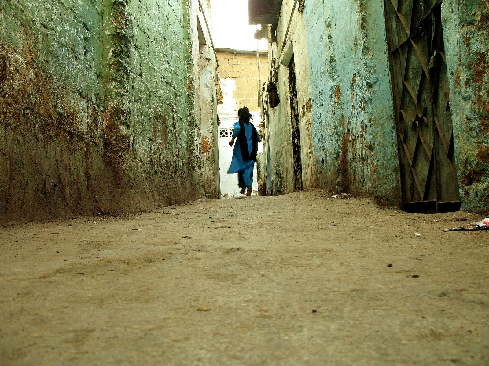 Girl in narrow alley