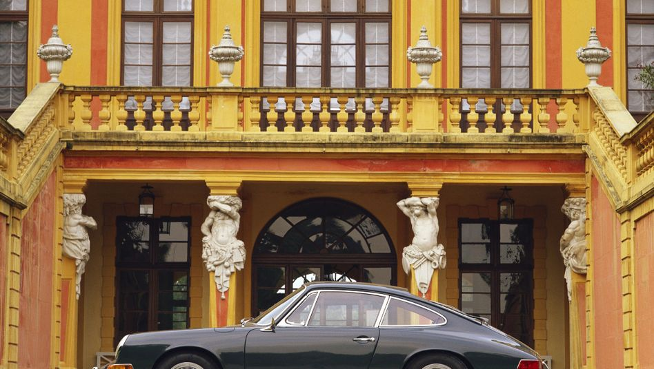 A Porsche sits in front of the Ludwigsburg Palace near Stuttgart.