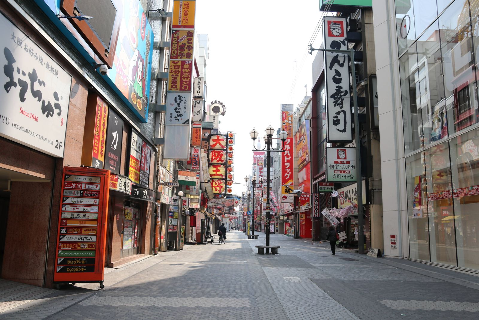 Few people are seen at Dotonbori shopping and amusement district in Osaka, Japan on April 8, 2020, a day after Japanese