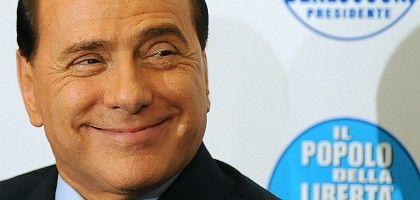 Silvio Berlusconi is sitting pretty after winning a clear majority in Italian elections.