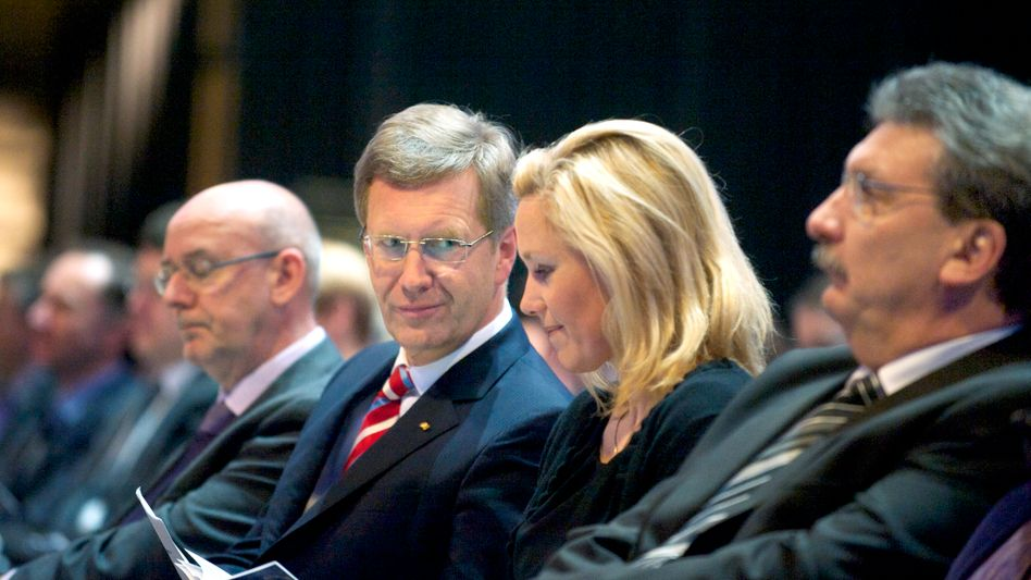 President Wulff (second from left) and his wife at a church service in Berlin on Sunday.