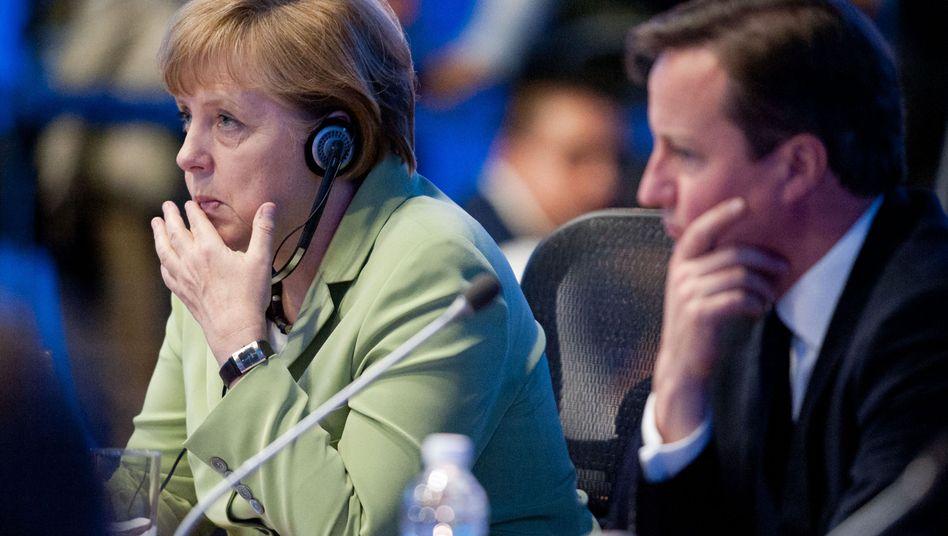 """Kanzlerin Merkel, Premier Cameron: """"Jeder Kontinent wird seinen Beitrag leisten müssen"""""""