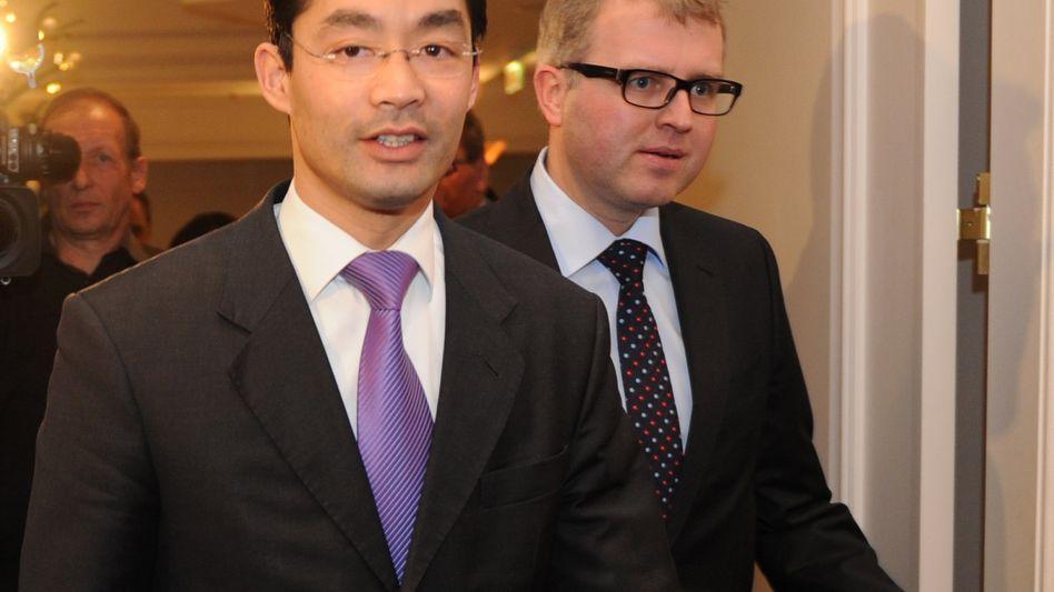 Schäffler, Rösler (rechts): Kontrahenten in der Rettungsschirm-Frage