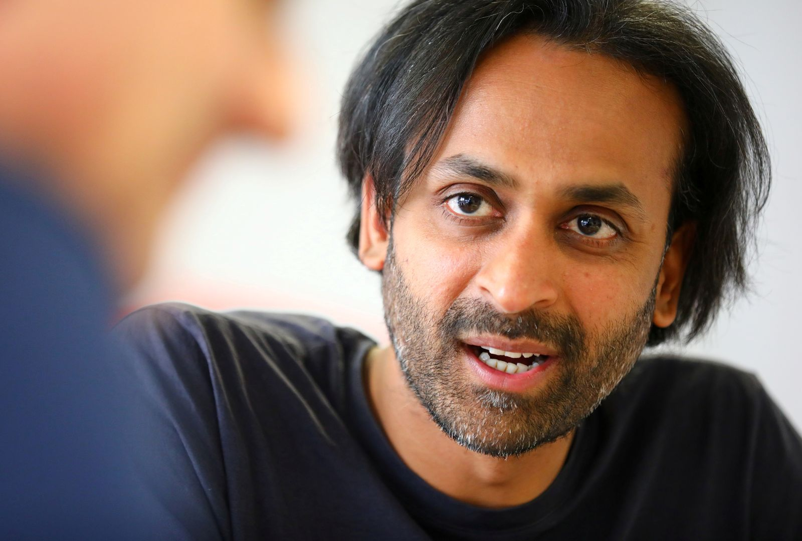 FILE PHOTO: Naren Shaam, the founder-CEO mobility app Omio, speaks during a Reuters interview in Berlin