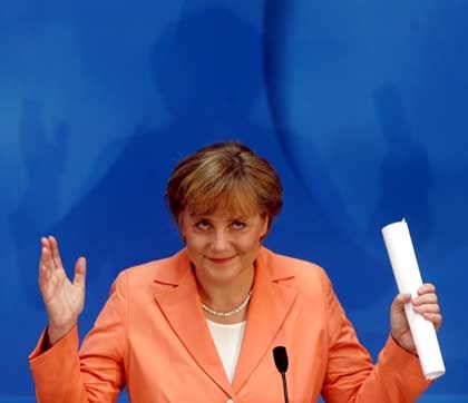 In September, Merkel could be raising her arms to embrace her supporters if she wins the election.