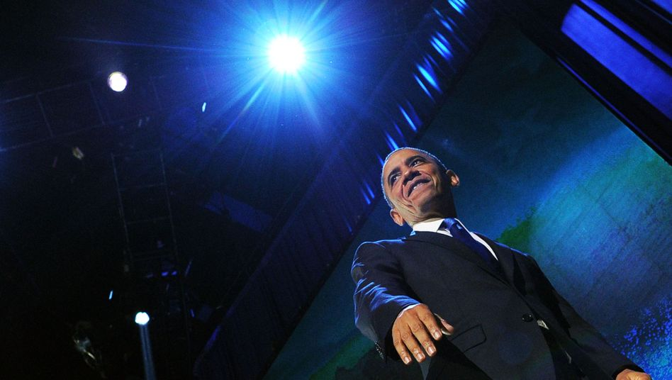 Obama smiles after delivering his victory speech on election night in Chicago.