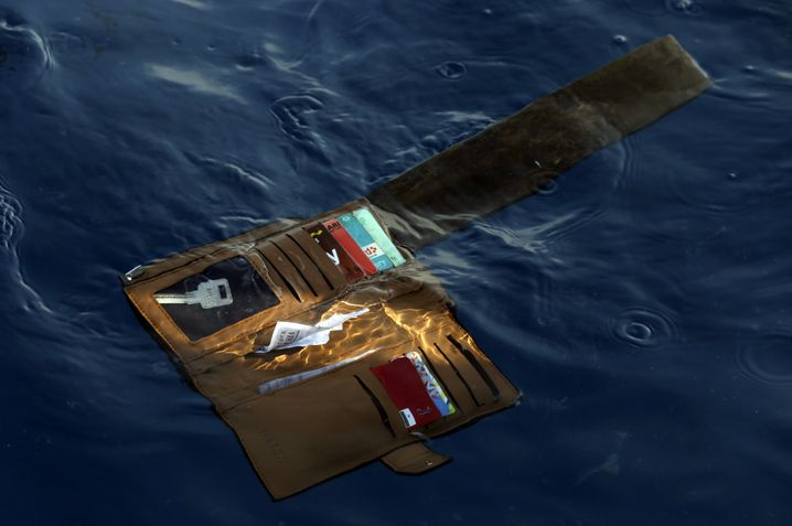 A wallet belonging to a victim of the Lion Air passenger jet that crashed floats in the waters of Ujung Karawang, West Java, Indonesia: The facts are clear -- 346 people are dead of unnatural causes in the two crashes of Boeing 737 Max jets.