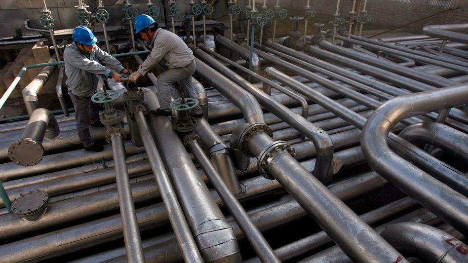 Ölarbeiter in China: Steigende Löhne bedeuten steigende Inflation