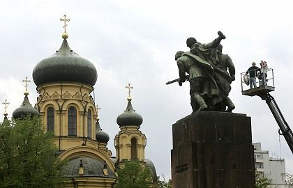 A monument to Red Army soldiers stands next to a church in Warsaw. Polish plans to remove some Soviet-era monuments are likely to cause conflict with Moscow.