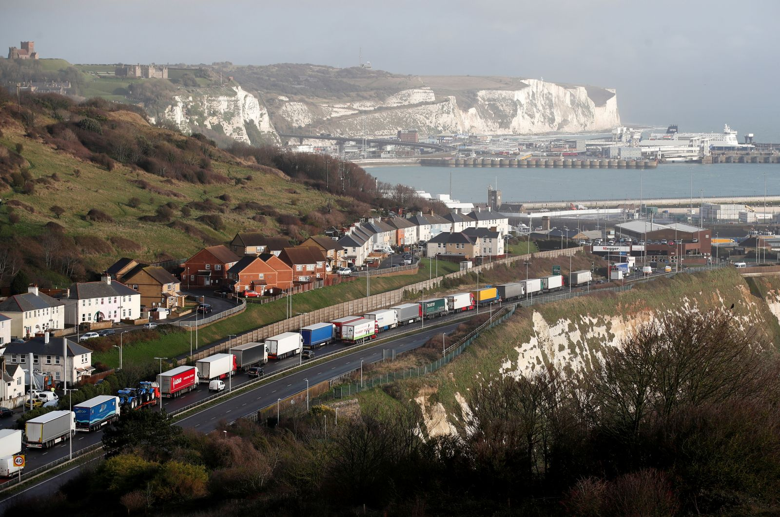 Lorries queue on the route into the port of Dover to board ferries to Europe
