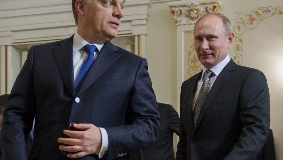 Orbán (l.) und Putin (Archiv): Der Ungar hofiert den russischen Präsidenten
