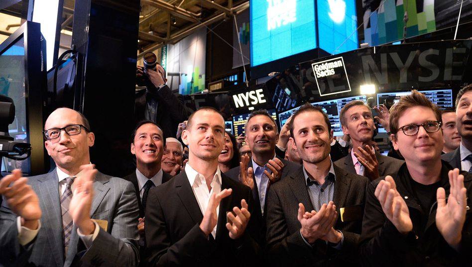 Twitter executives and founders at the New York Stock Exchange on Nov. 7 clap as their company launches its initial public offering.
