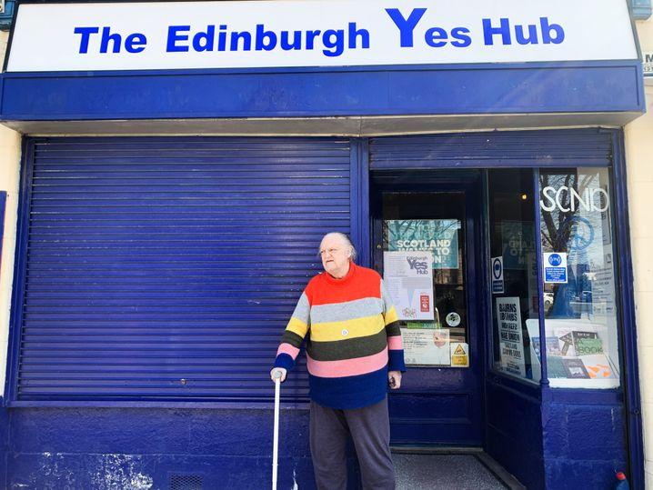 Mike Blackshaw standing in front of his shop in Edinburgh