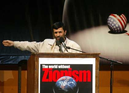 """Iranian President Mahmoud Ahmadinejad speaks during a conference on Wednesday Oct. 26 in Tehran entitled 'The World without Zionism.' He said Israel should be """"wiped off the map."""""""