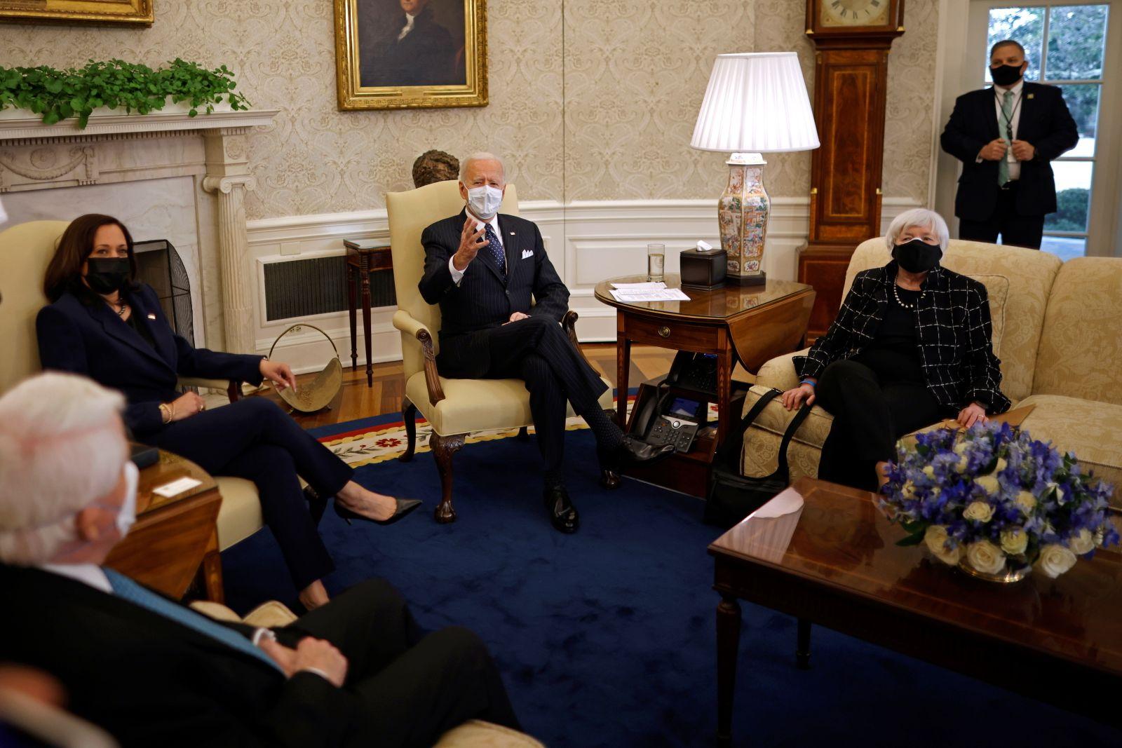 U.S. President Joe Biden and U.S. Vice President Kamala Harris, accompanied by U.S. Treasury Secretary Janet Yellen attend a meeting business leaders at the Oval Office of the White House in Washington, U.S.