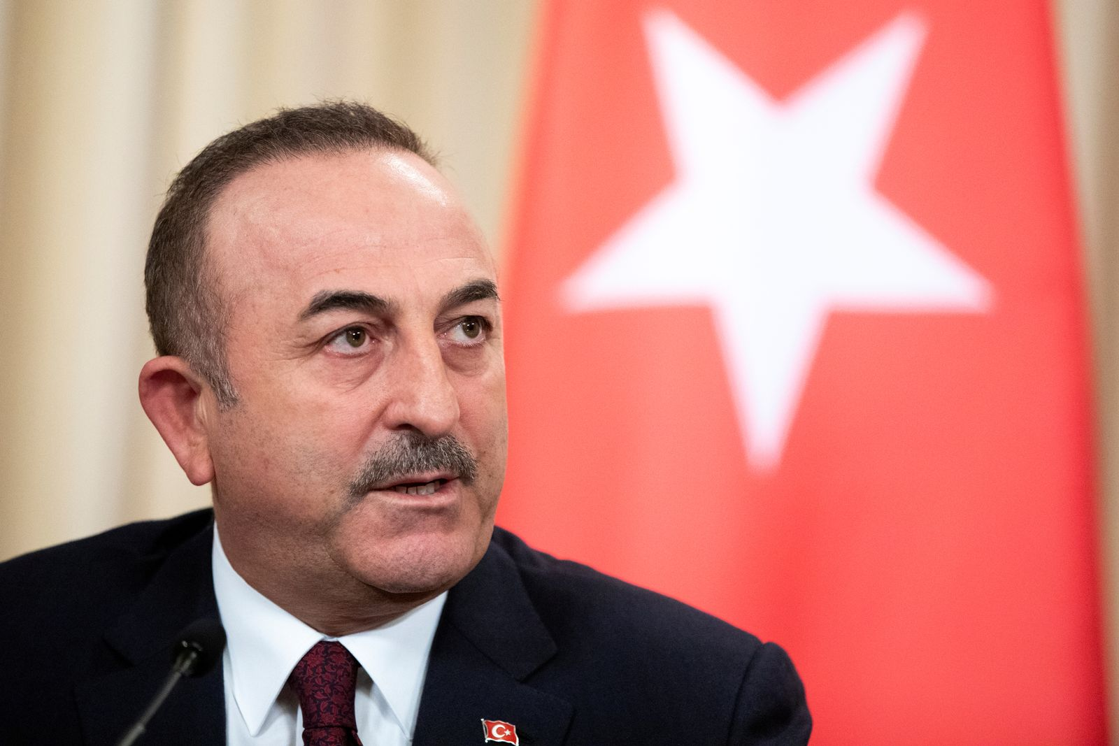Turkish Foreign Minister Mevlut Cavusoglu speaks during a joint news conference following talks with Russian Foreign Minister Sergei Lavrov in Moscow