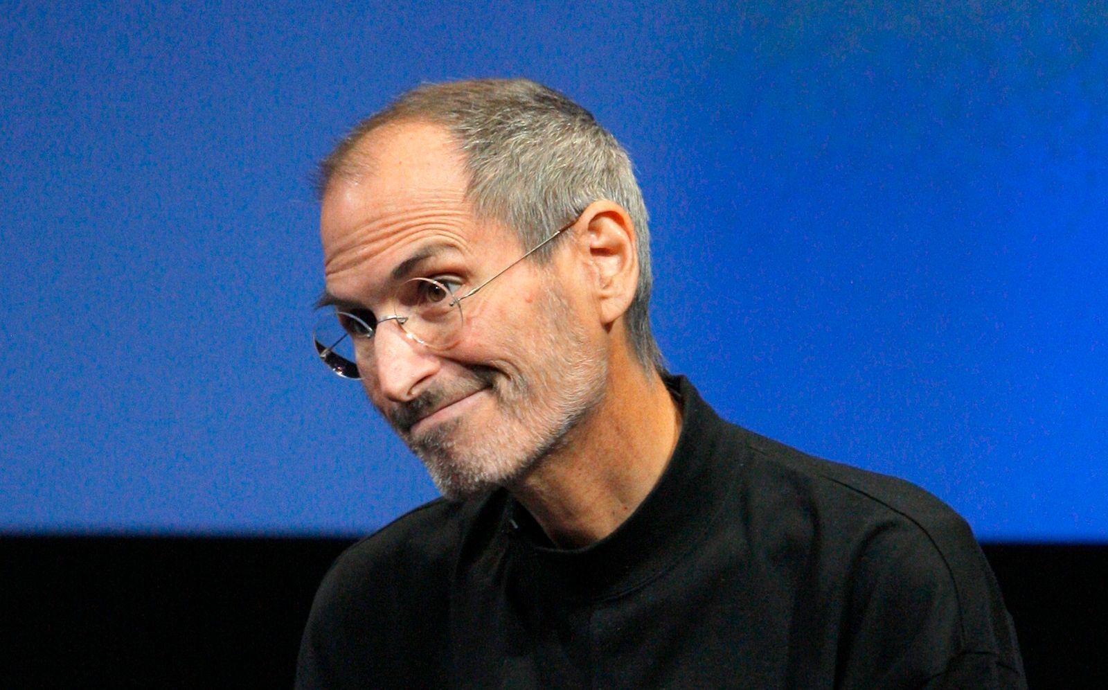 Apple Inc. CEO Steve Jobs smiles during a Q&A session at the end of the iPhone OS4 special event at Apple headquarters in Cupertino