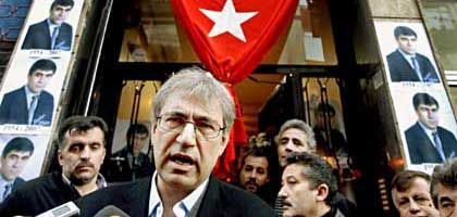 "Author Orhan Pamuk standing in front of the home of murdered journalist Hrant Dink: ""I am furious at everyone and everything."""