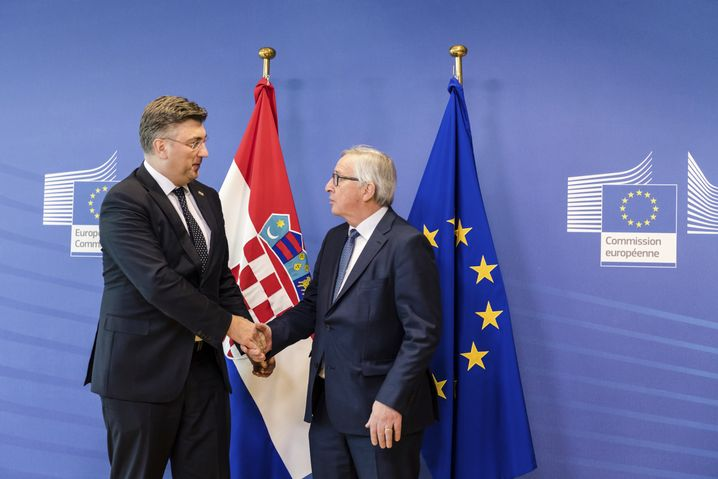 European Commission President Jean-Claude Juncker (right) welcomes Croatian Prime Minister Andrej Plenkovic upon his arrival at EU headquarters in Brussels in February.