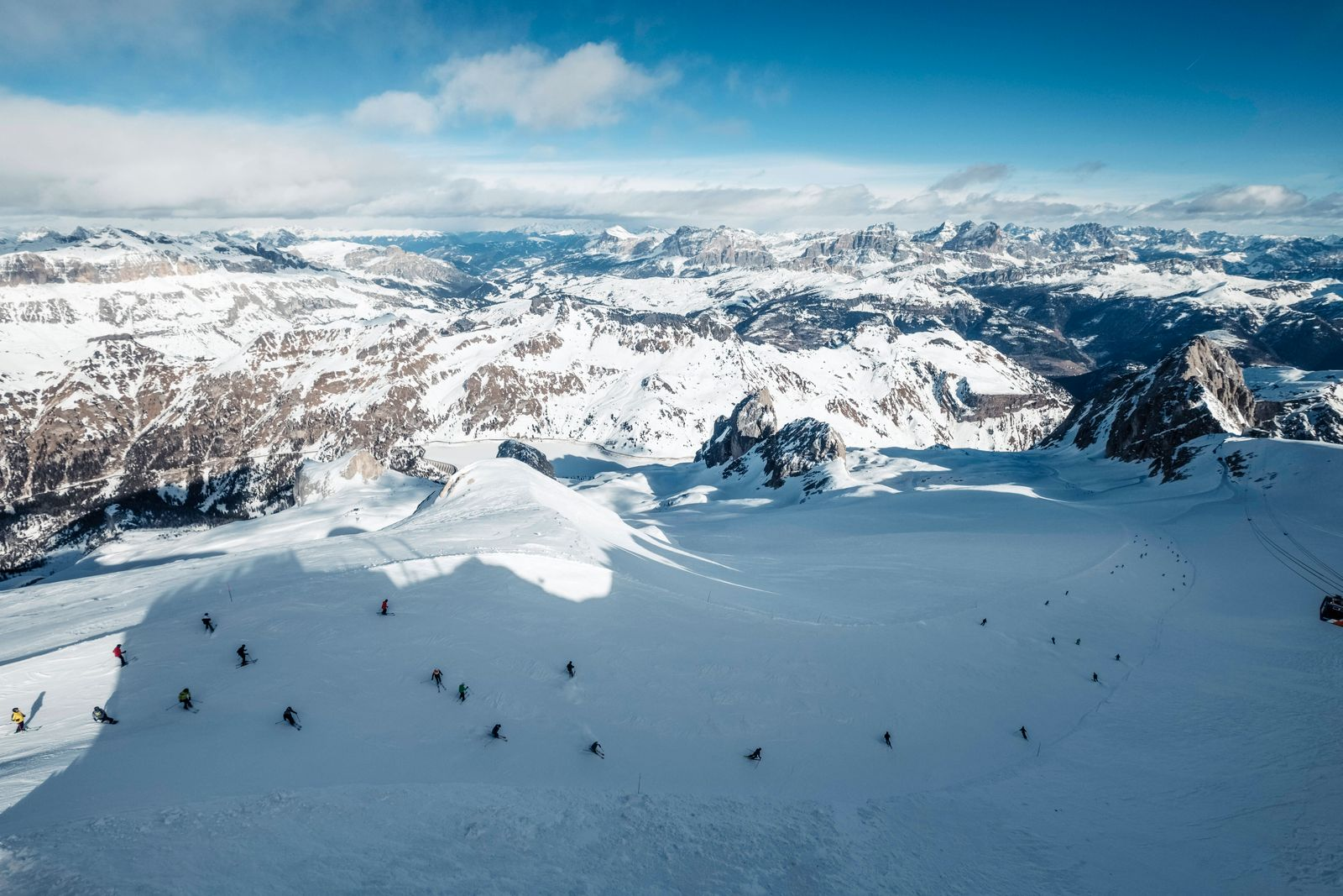 Italy, Trentino, Skiers seen from summit of Marmolada mountain WFF00447