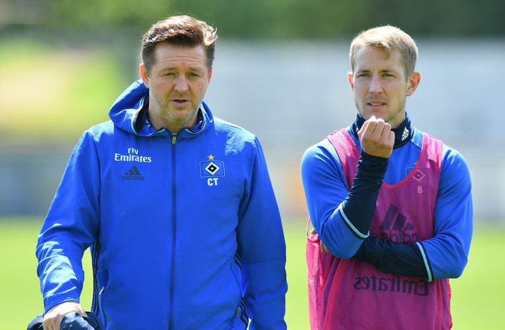 Trainer Christian Titz (links) und Lewis Holtby