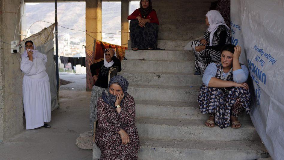 Jesidische Frauen auf der Flucht: Grausame Verbrechen durch IS-Kämpfer