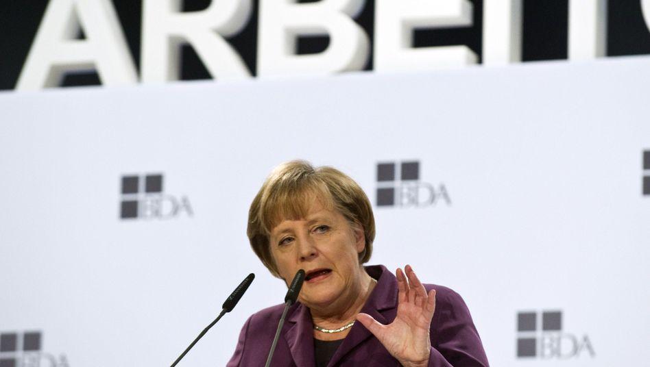 Merkel auf der Arbeitgebertagung in Berlin: Deutliche Worte zu den Euro-Bonds