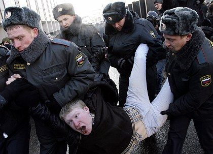A member of the National Bolshevik Party is arrested by police officers on January 31, 2009 during an opposition rally in the center of Moscow.