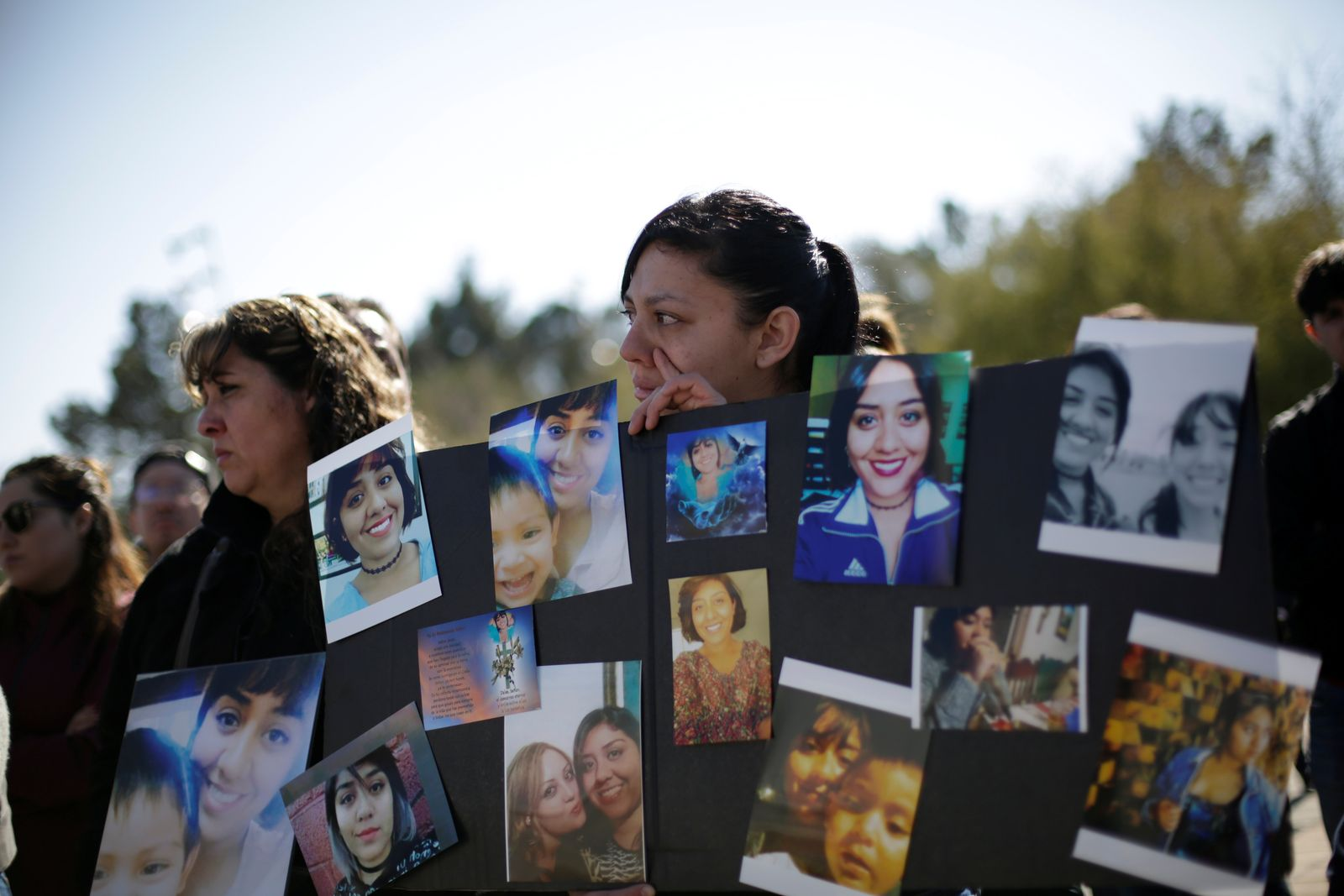 Women react while holding a placard with pictures of Isabel Cabanillas, an activist for women rights whose body was found last Saturday, during a protest to demand justice for her murder, in Ciudad Juarez