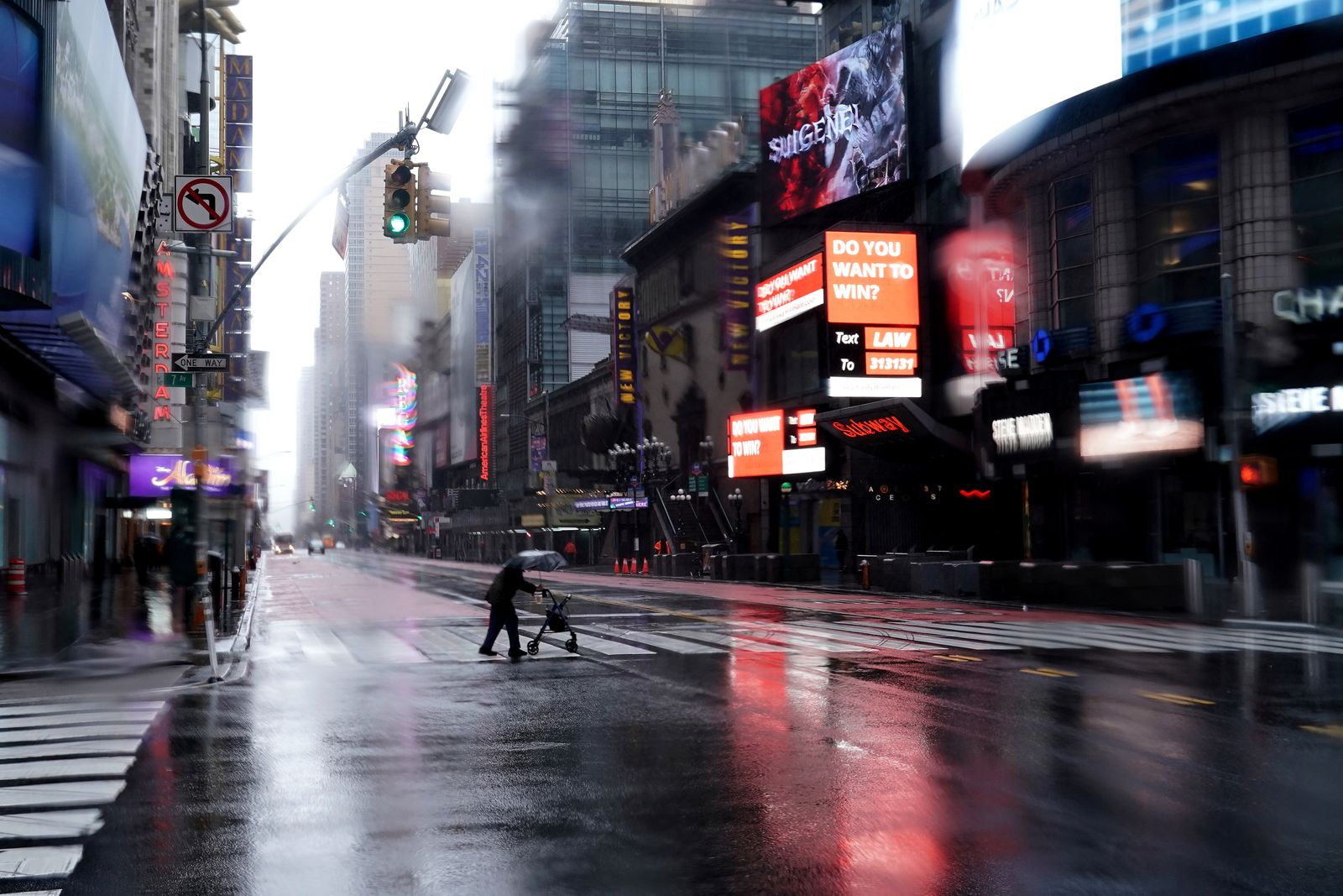 Person with a walker crosses 42nd Street in Manhattan