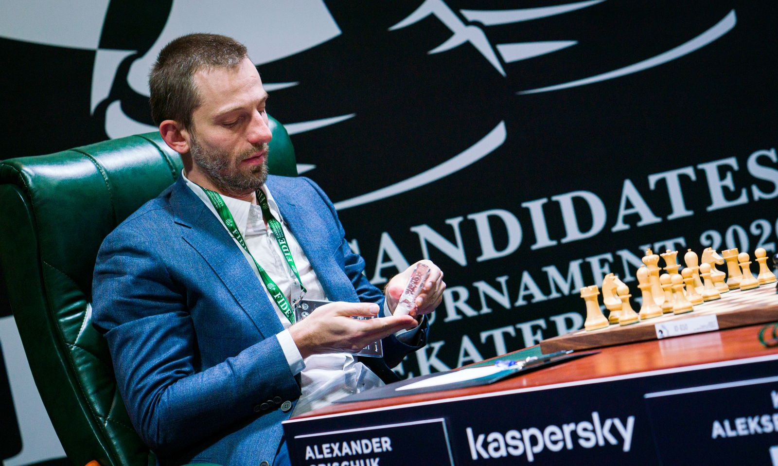 Russian chess player Alexander Grischuk uses hand sanitiser as he takes part in the Candidates Tournament in Yekaterinburg