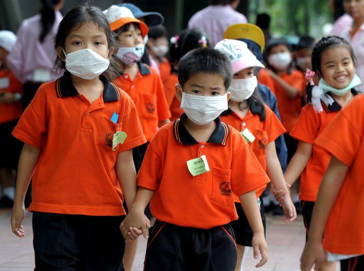 Schüler in Thailand: Schweinegrippe-Virus gefährlicher als saisonale Grippe