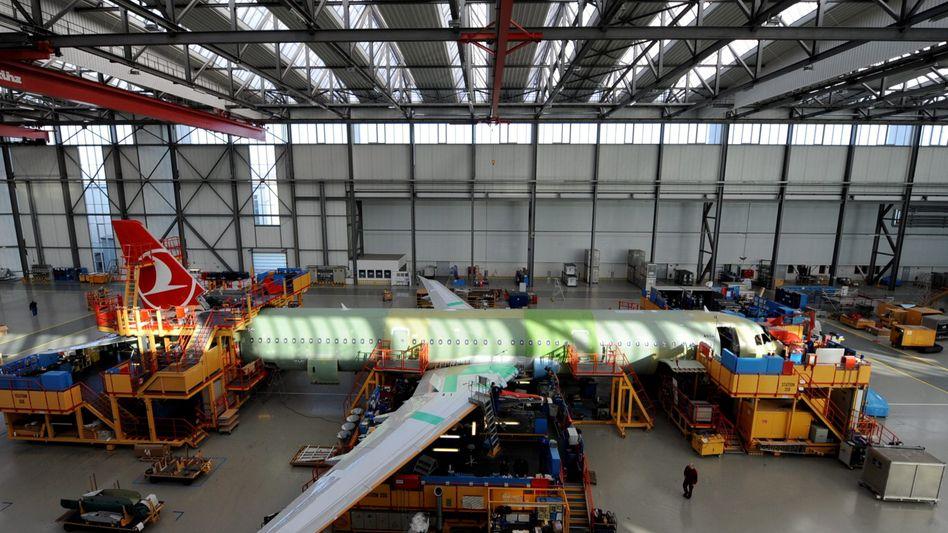 Workers at a Hamburg Airbus factory.