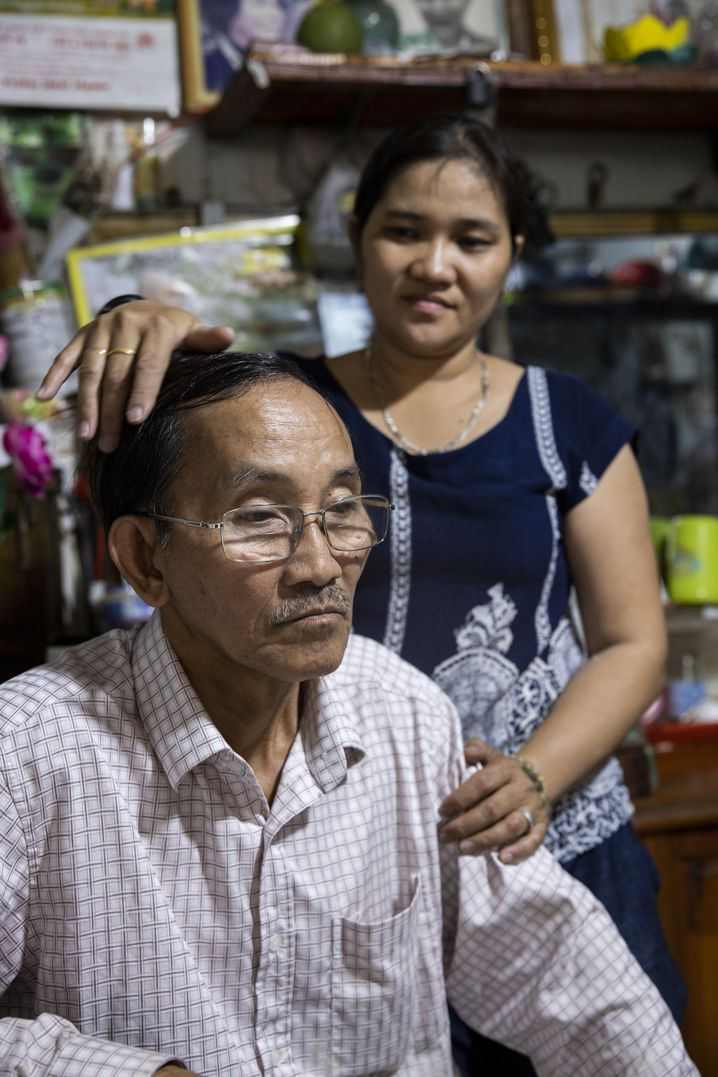 Nguyen Van Bat with his daughter Thi.