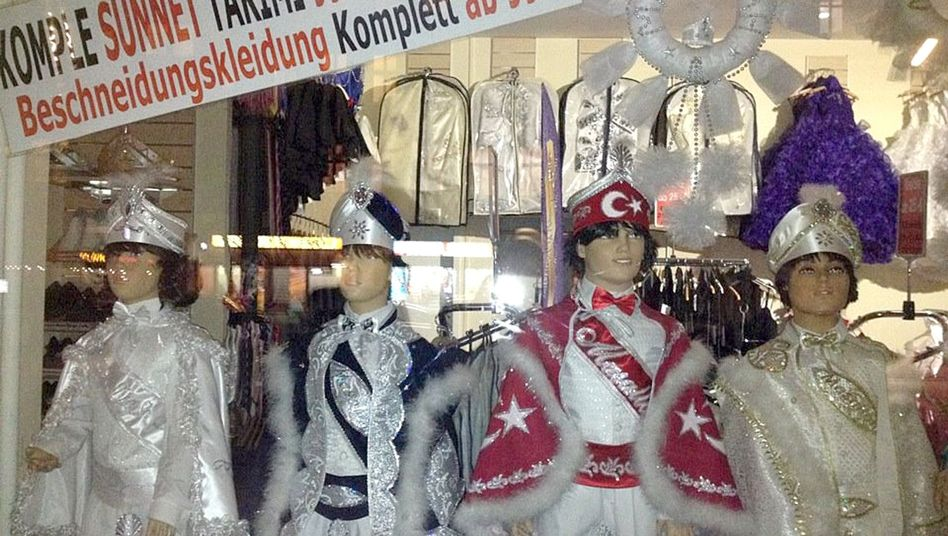 A shop window in Berlin's Kreuzberg district displays special clothing for circumcision celebrations in Germany's Muslim community.