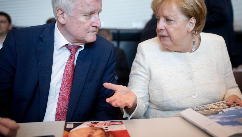 Seehofer, Merkel